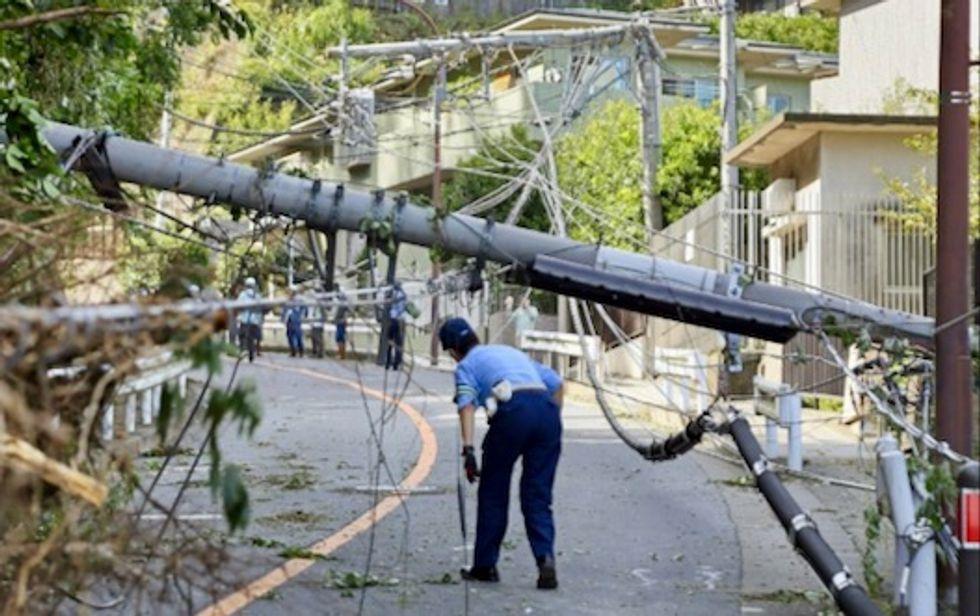 Two dead, travel chaos, after powerful typhoon pummels Tokyo
