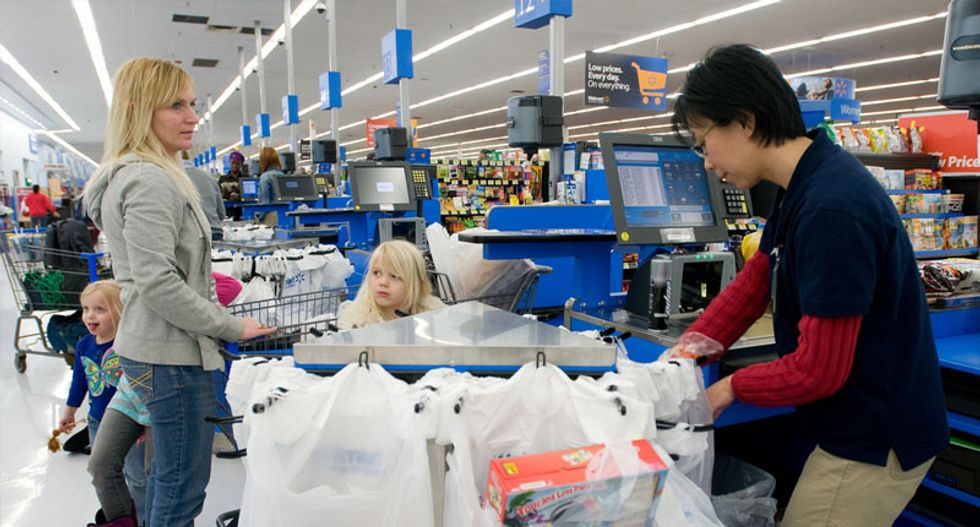 Walmart to finally raise wages for half a million workers -- but still no 'living wage'