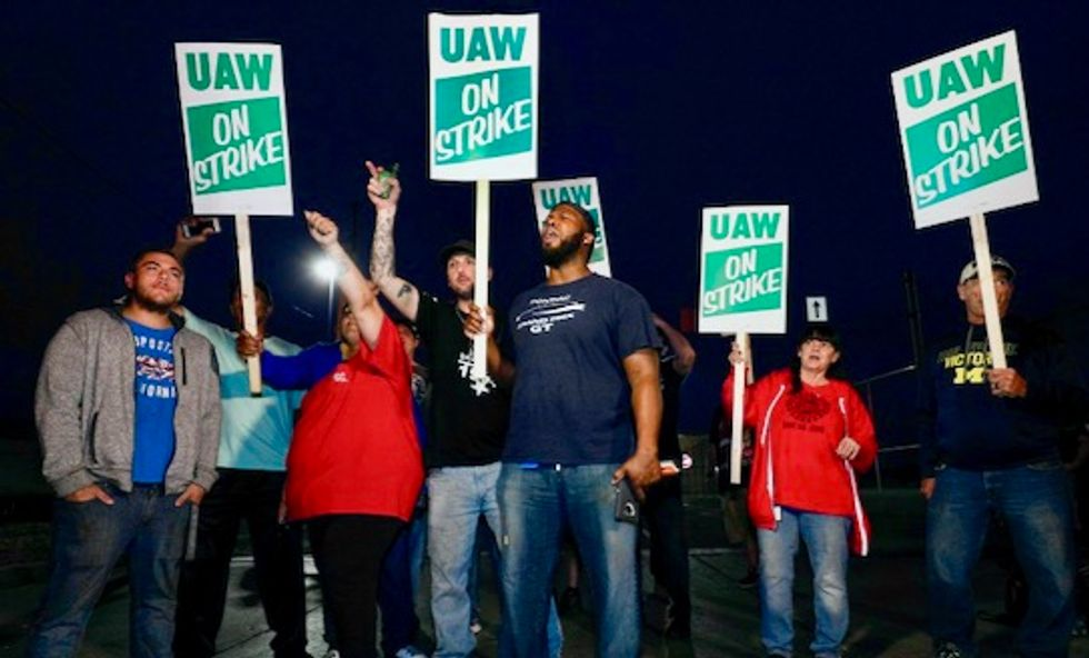 Under pressure from labor leaders and striking workers, GM agrees to fund health coverage during walkout