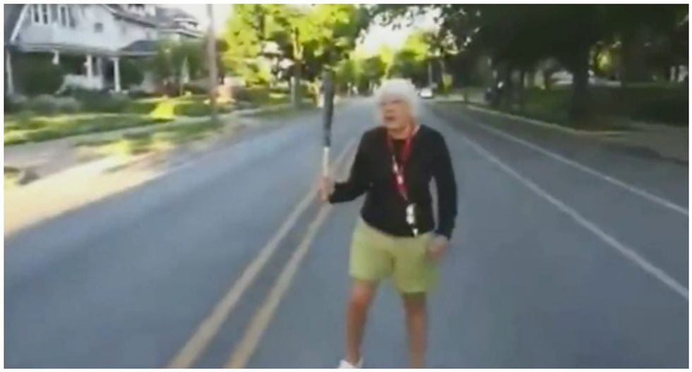WATCH: Bat-wielding 75-year-old white woman tries to block peaceful protesters from marching