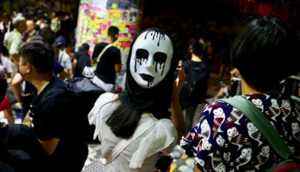 Defiant masked demonstrators protest Hong Kong face cover ban