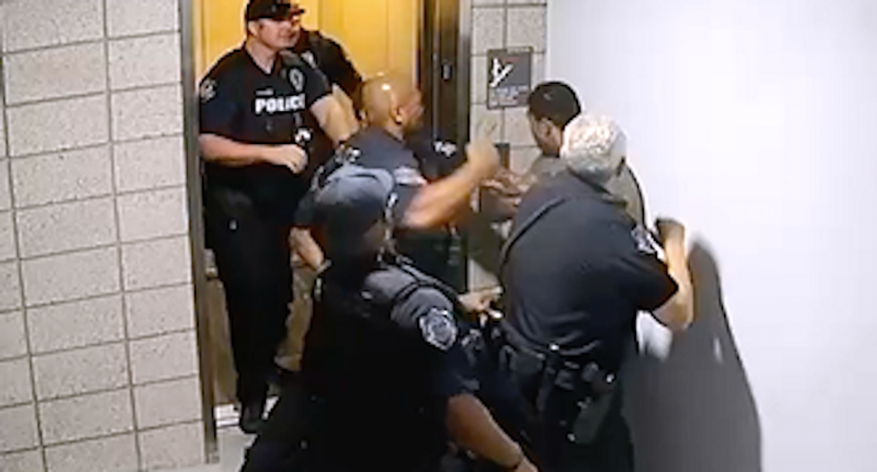 Video shows Arizona cops instantly start punching black man talking on cell phone