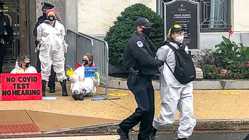 Amy Coney Barrett supporters shout 'law and order' as protesters are arrested outside confirmation hearing