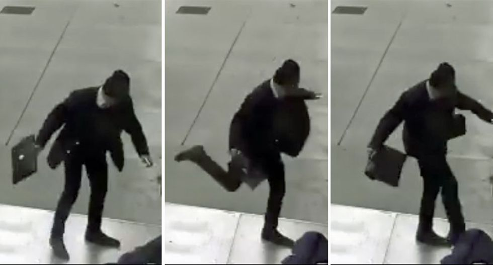 Man in suit caught on tape kicking homeless person's head in unprovoked attack