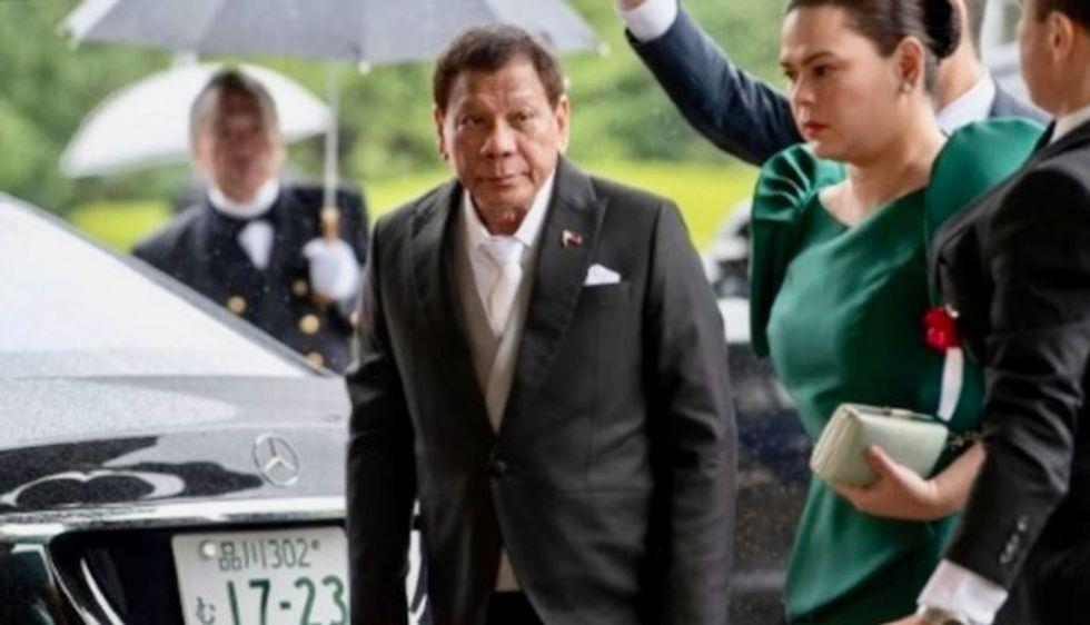 Philippines' Duterte cuts short Japan trip in 'unbearable pain'