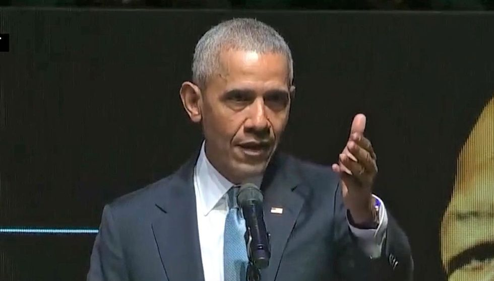 Obama absent from Democratic White House race but looming large