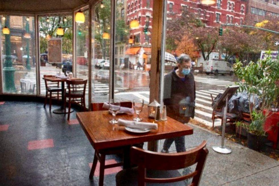New York closes bars to curb virus resurgence as deaths top 1.3 million