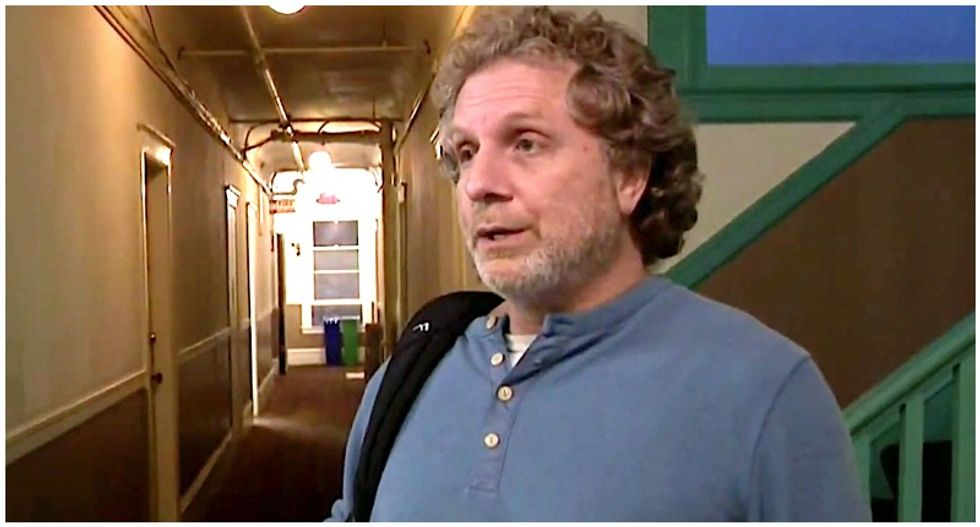 WATCH: Woman finally confronts man who's been spewing racist rants in her hallway for years