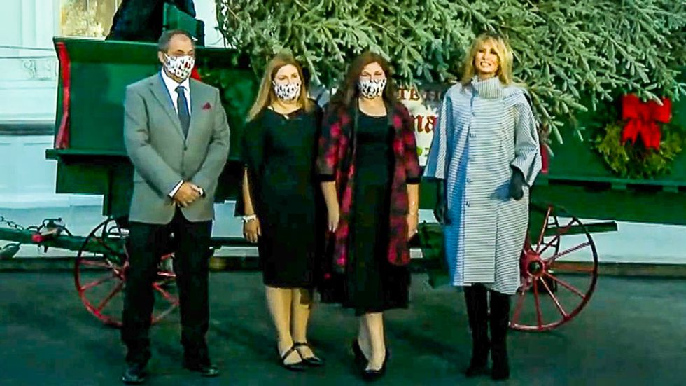 WATCH: Melania Trump goes maskless as she participates in White House Christmas tree delivery