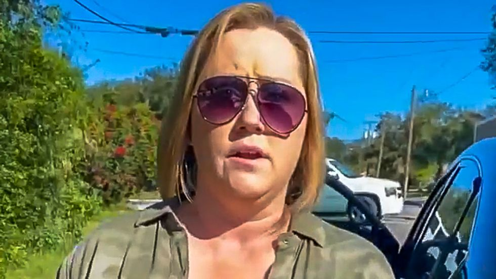 White woman caught stealing anti-Trump sign lectures Black man for 'disrespecting the current president'