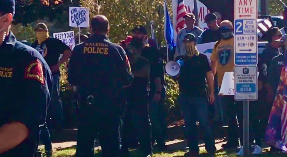 'We will exterminate you': Proud Boys and other right-wing Trump diehards confront counter-protesters at Raleigh rally