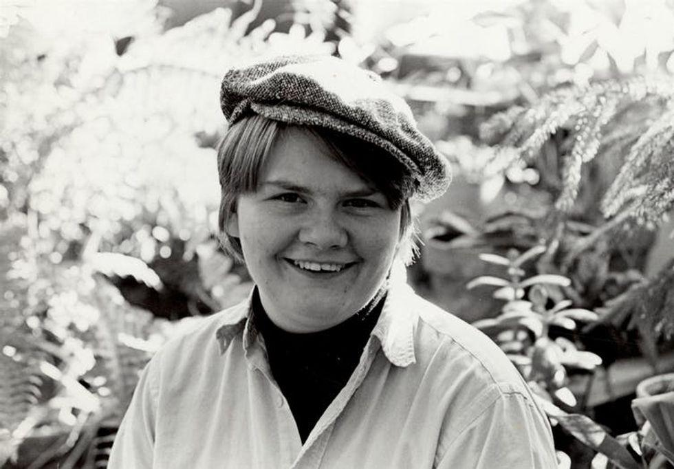 Black-and-white photo of Kozachenko wearing a newsboy hat