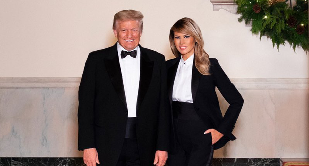 There's rampant speculation Melania's Christmas card is photoshopped with an old Trump picture