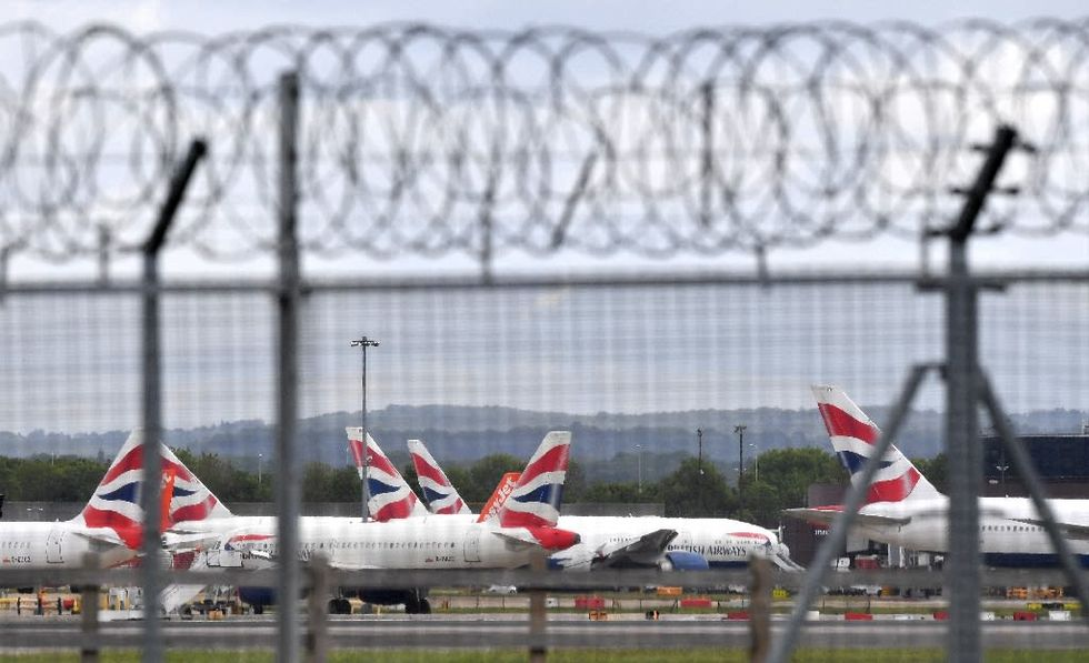 Britain holds crisis meeting over virus travel ban