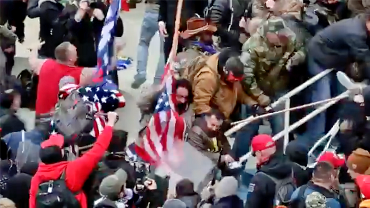 Arrested Capitol rioter claims he thought officer he beat with US flagpole was 'antifa': report