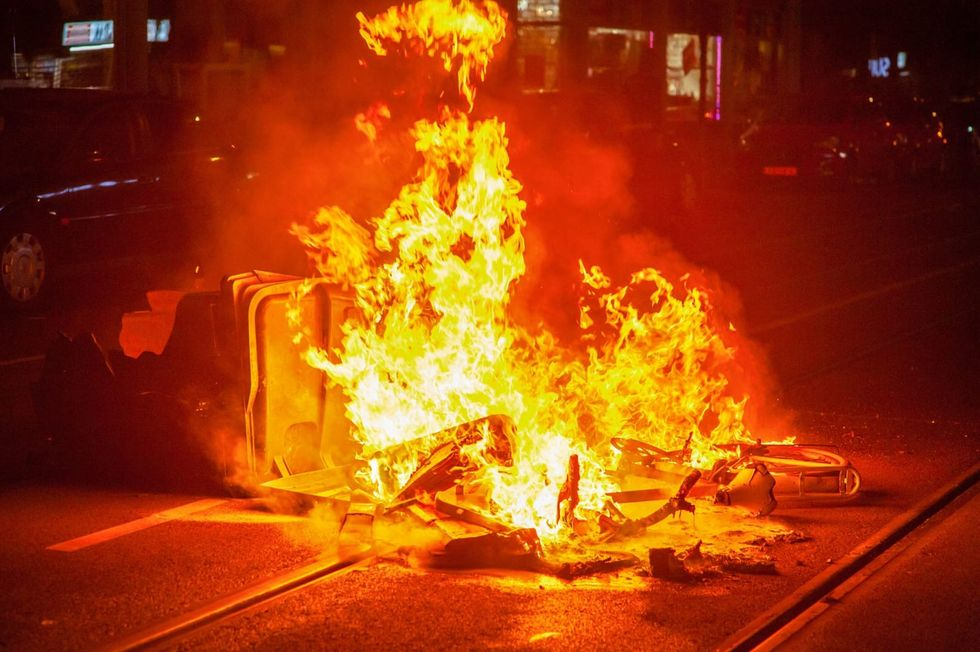 Netherlands sees another night of violent protests against curfew