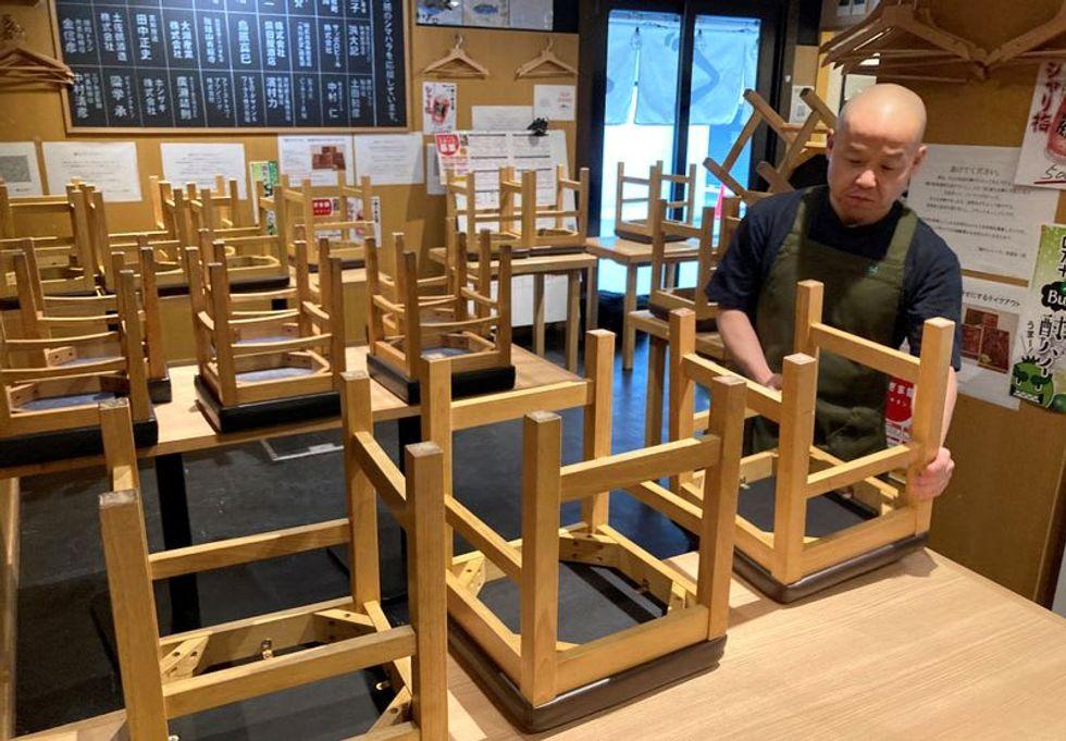Japan's COVID crisis reawakens deflation fears as cash hoarding returns