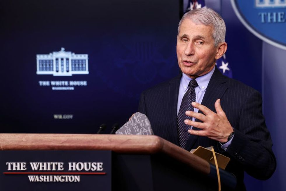 Fauci says it is possible Americans will still be wearing masks in 2022