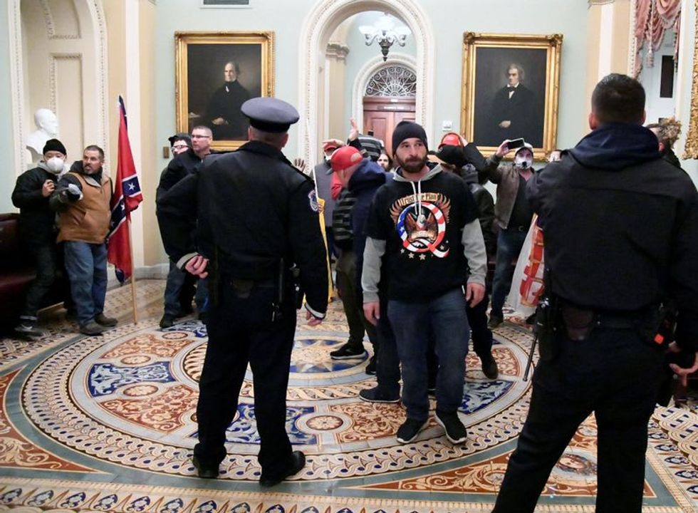 Former US House sergeant-at-arms denies 'optics' dictated security at Capitol on Jan. 6