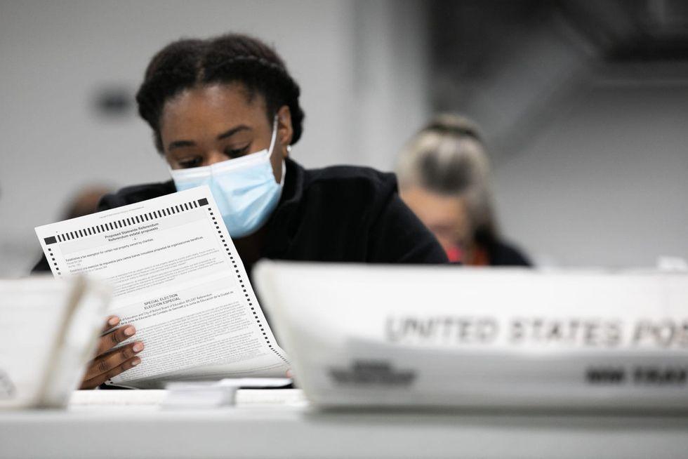 Georgia lawmakers revise bill setting absentee ballot request deadline
