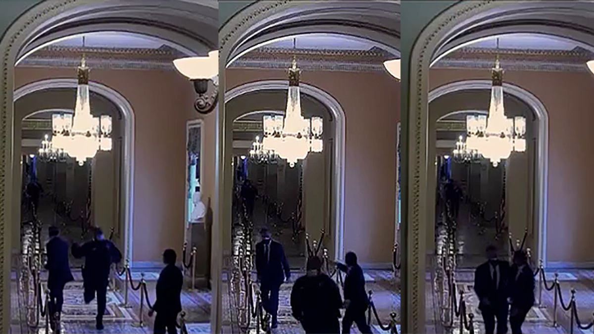 Security footage shows Mitt Romney led to safety by Capitol officer after he was headed towards attackers