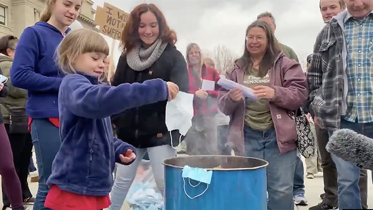 'Very close to child abuse': Doctor attacks protest where parents force children to burn masks