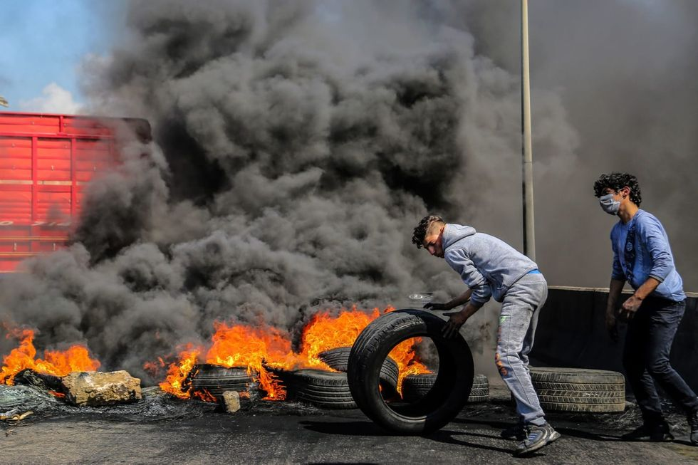 Lebanese protesters declare 'day of rage,' block major roads