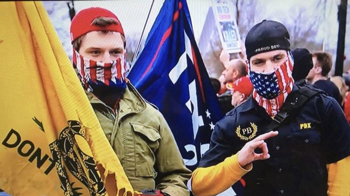 FBI arrests Oregon Proud Boys for helping others break barriers into the Capitol