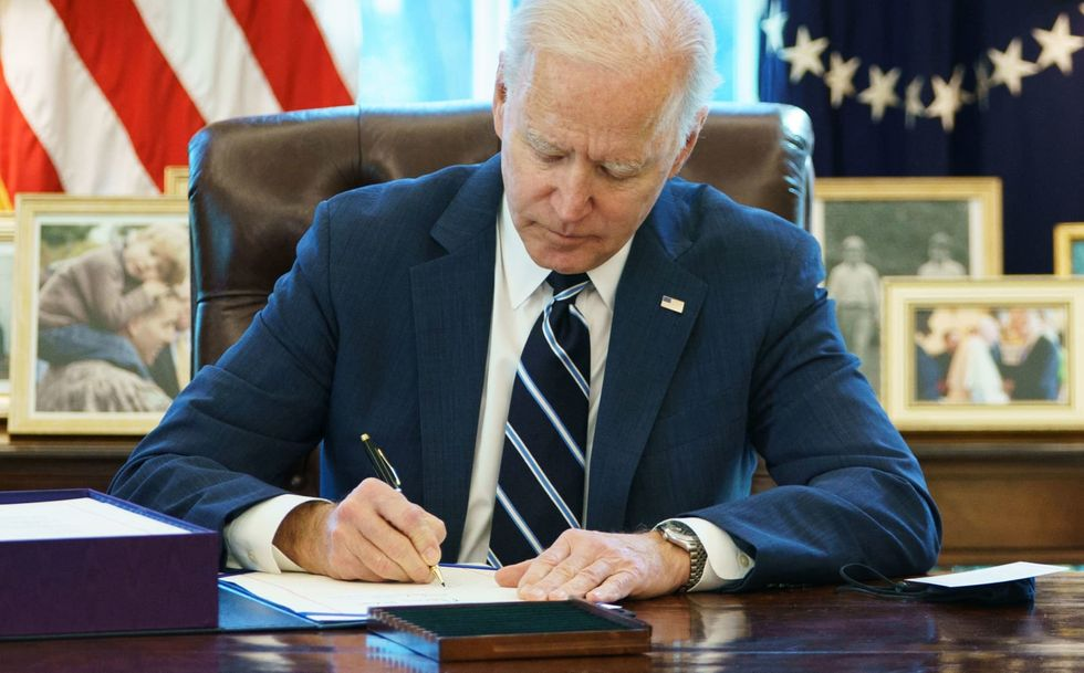 Biden signs $1.9 trillion COVID relief bill in first major legislative victory