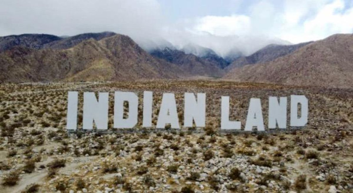 Vast 'Indian Land' sign draws visitors to Desert X art festival in the Coachella Valley