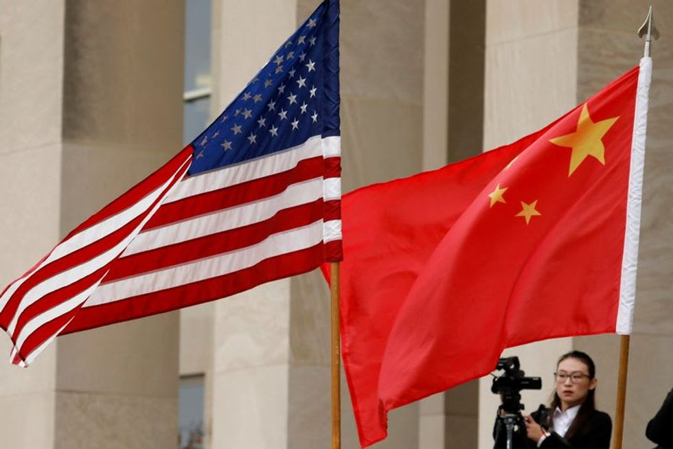 Beijing huddles with friends, seeks to fracture U.S.-led 'clique'