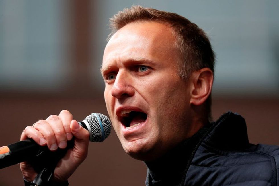 Allies of Russia's Navalny defiant in face of possible extremism charges