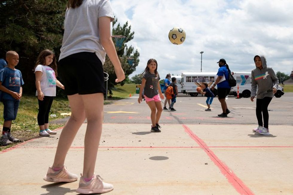 U.S. CDC says children can get within 3 feet at summer camp