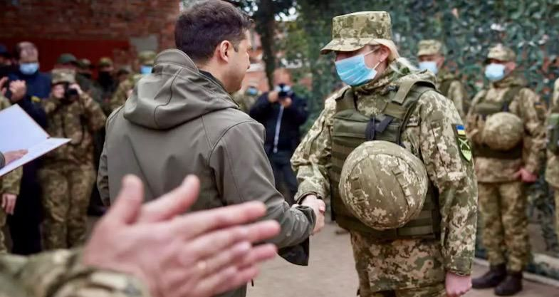 Ukraine's Zelensky on frontline as Merkel urges Putin to pull back troops