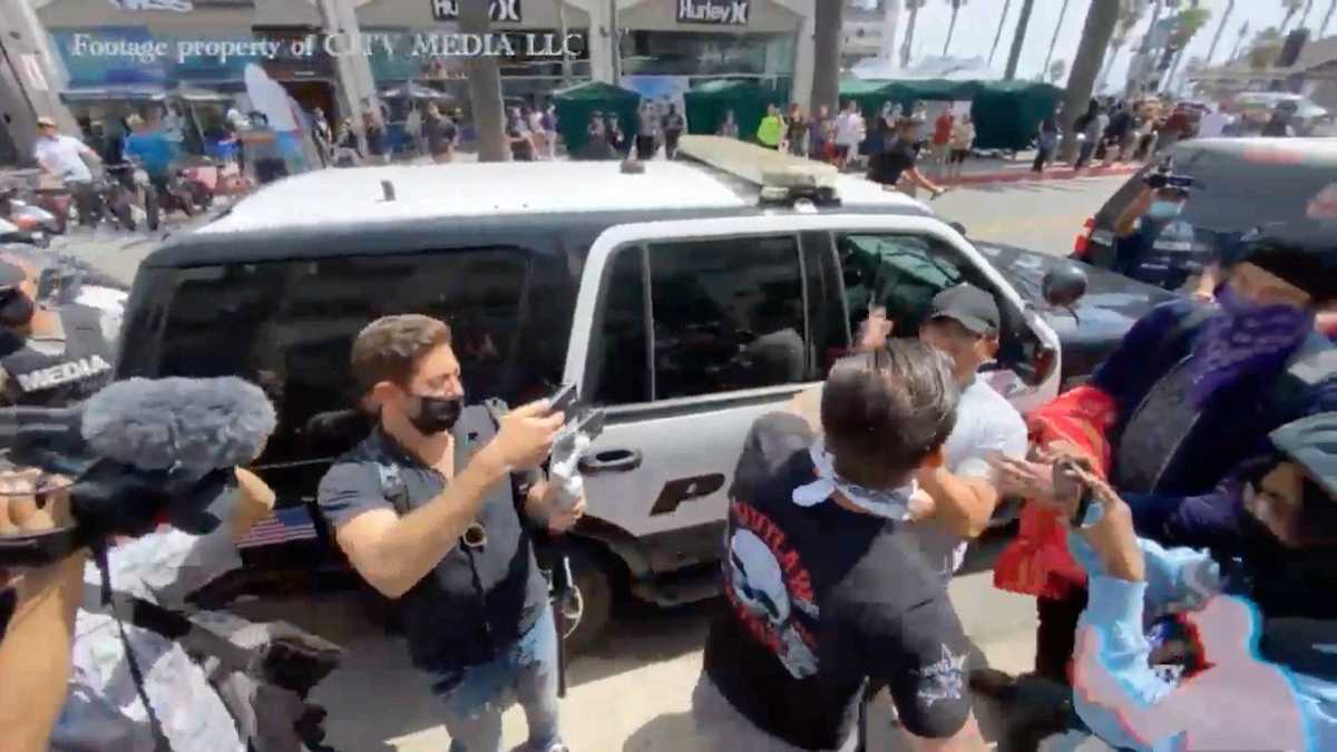 WATCH: 'White lives matter' turns violent when protester punches man in front of police car