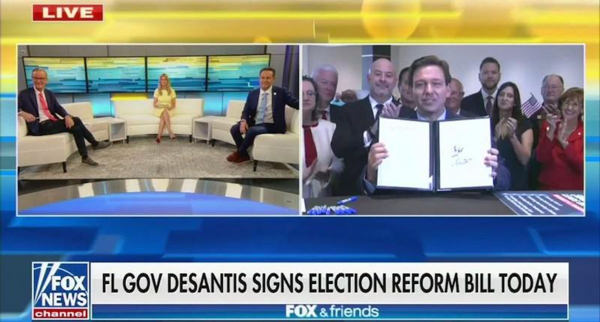 'How fascists operate': Ron DeSantis slammed for signing anti-voting bill behind closed doors for Fox