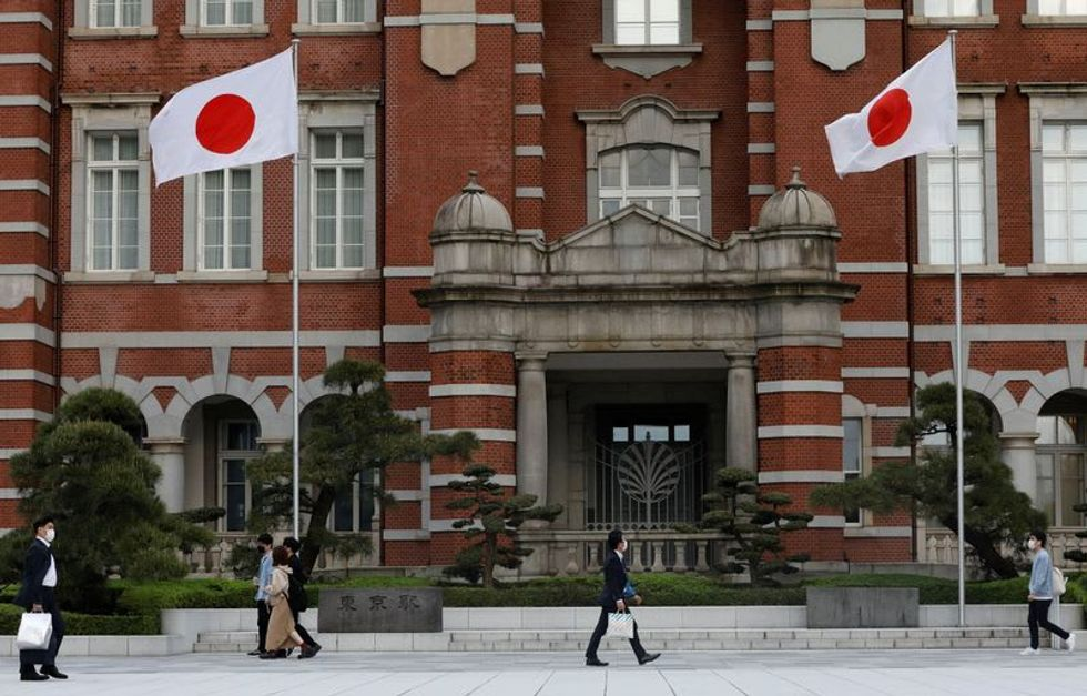 Japan faces longer state of emergency, casting doubt on Olympics