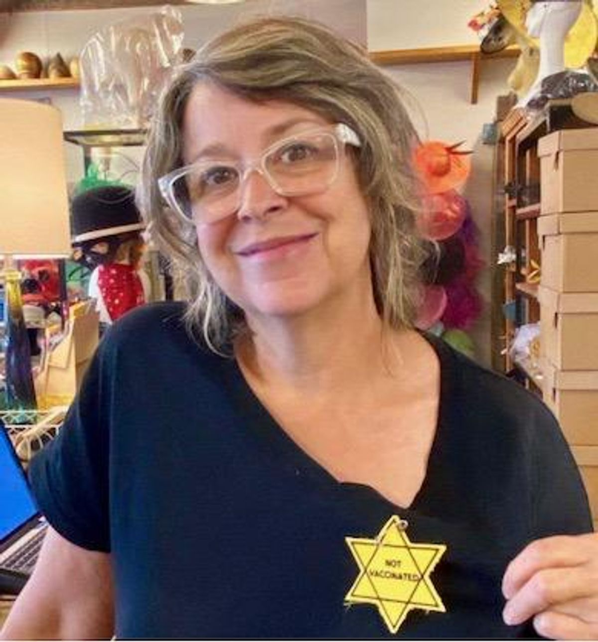 Tennessee Hat Shop Under Fire for Promoting 'Not Vaccinated' Star of David Patch on Social Media