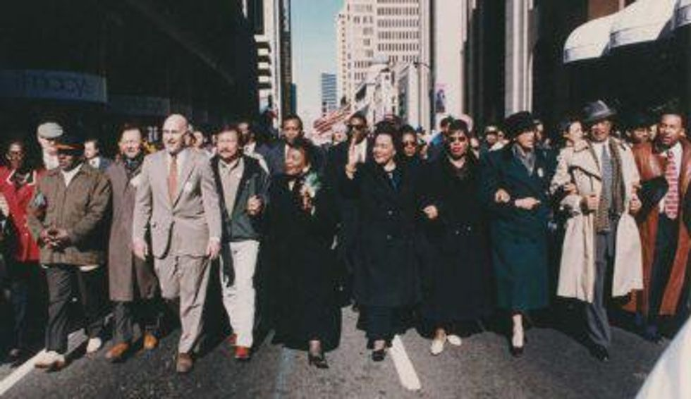 Ira Glasser (at left in beige suit) marching in Atlanta, GA, with Coretta Scott King (center) and others in 1997 Martin Luther King, Jr. Day parade.