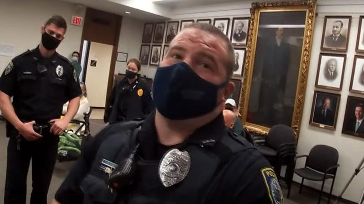 WATCH: Anti-masker arrested after he refuses to stop ranting about the Earth being flat at city council meeting