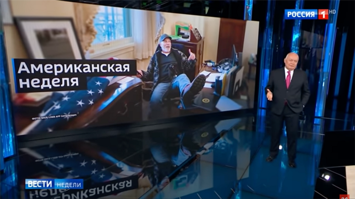 Russian state TV debuts insurrectionist who raided Pelosi's office ahead of Biden's meeting with Putin