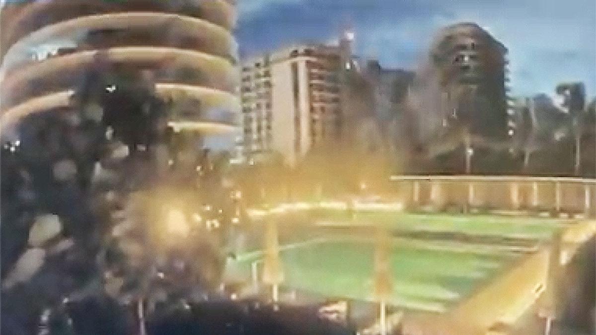 Surveillance video captures the horrifying moment the Surfside condo crumbled in Florida
