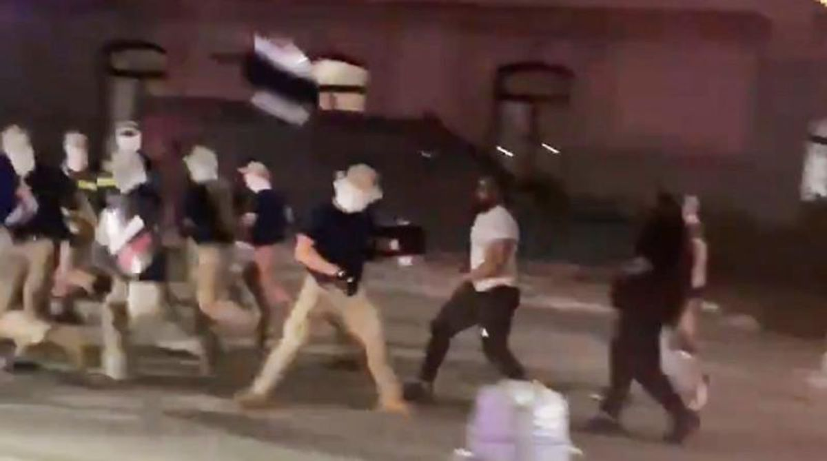 WATCH: Onlookers chase white supremacists marching in front of Philadelphia City Hall