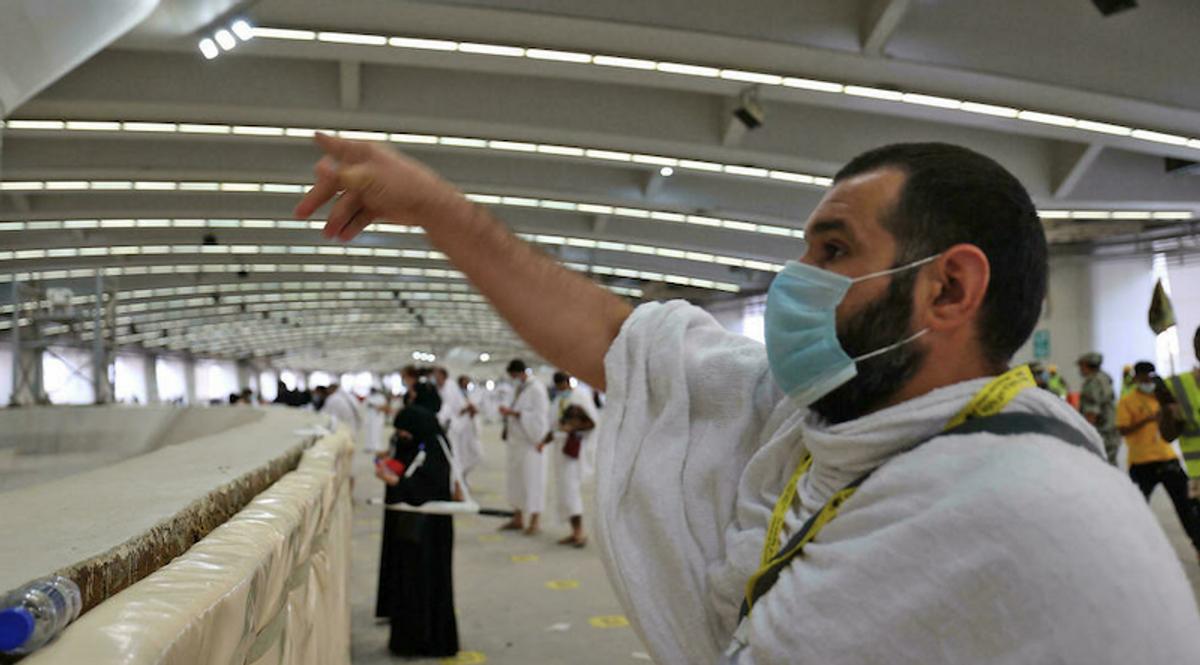 Pilgrims 'stone the devil' with sanitized pebbles in hajj ritual