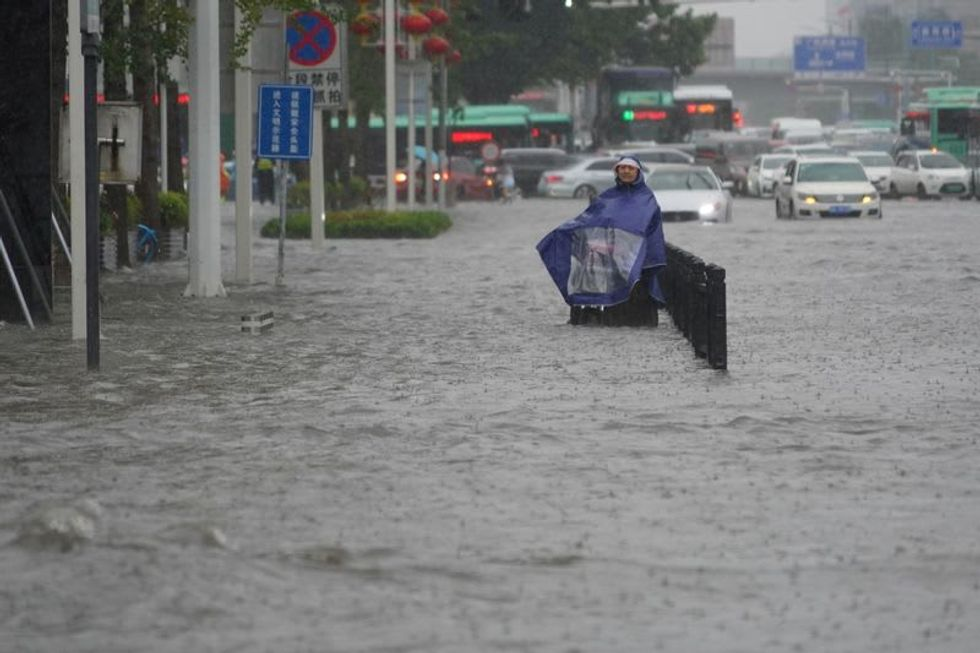 Central Chinese province swamped after once-in-millennium rainfall