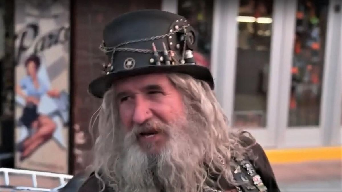WATCH: Sturgis biker bursts out coughing as he tells CNN why he won't get the COVID vaccine