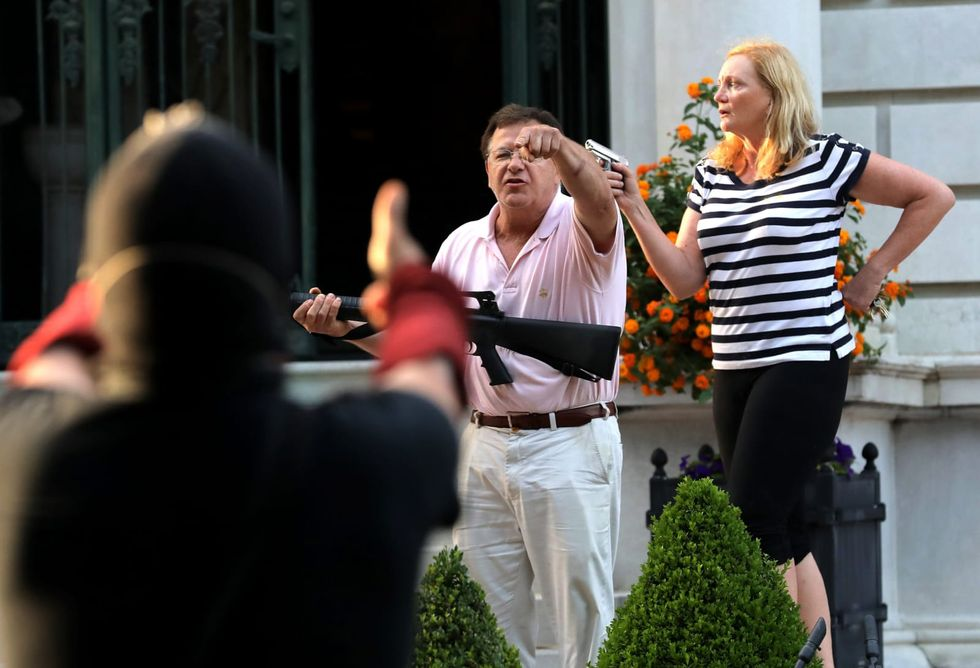 Gun-waving St. Louis vigilante couple pardoned by Missouri governor