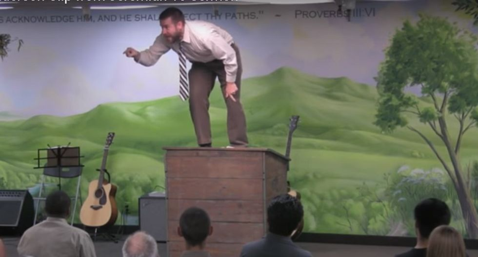 'Kill the gays' pastor has a pulpit-stomping meltdown after he's booted from online fundraising