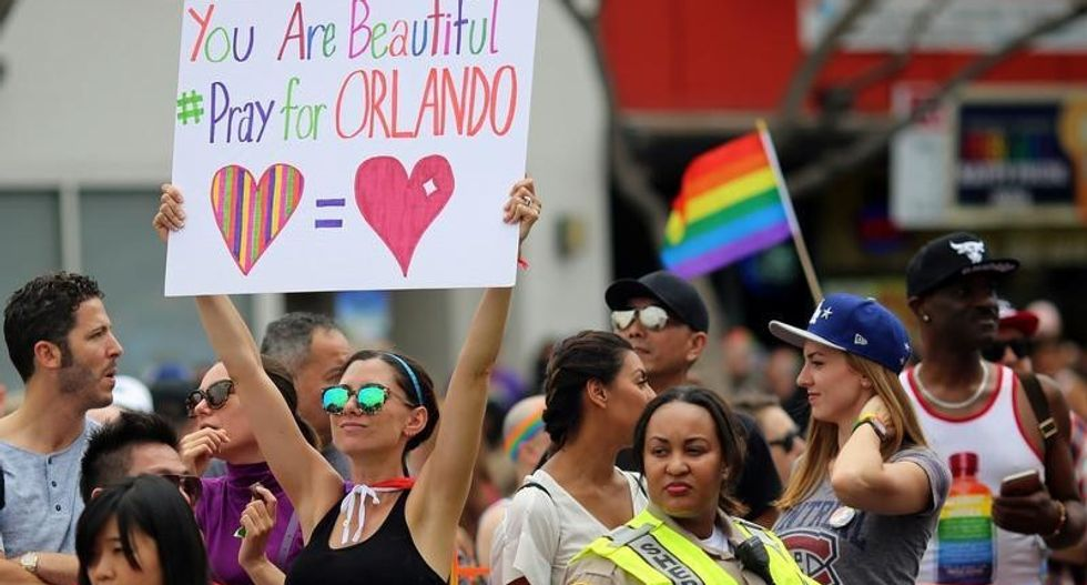 LGBT Pride parades tinged with sadness after Orlando massacre