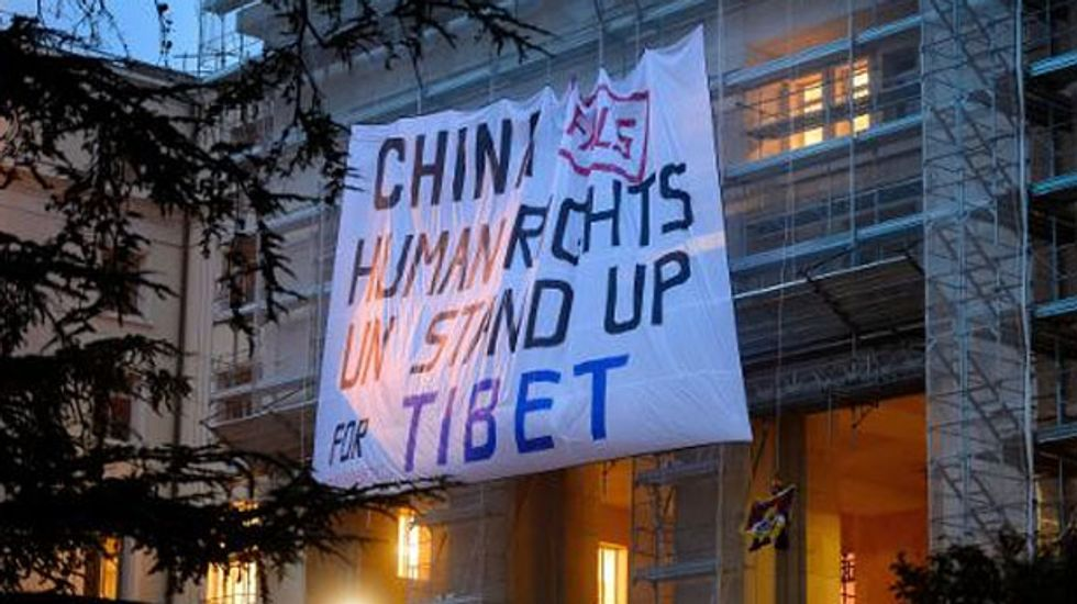 Tibetan protest at UN against China rights abuses